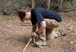 Using a bowdrill to start a fire