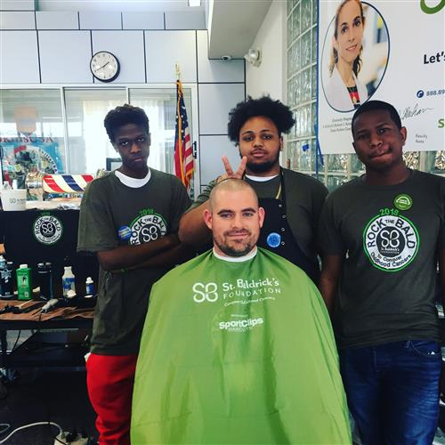 Mr. Wallace donates his hair in honor of the St. Baldrick's Foundation