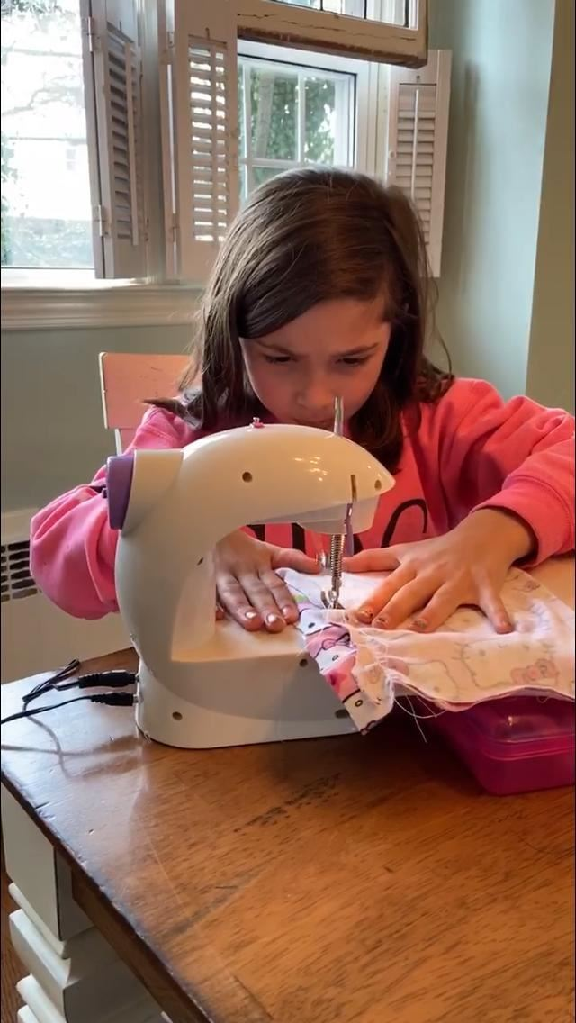 Daughter Christina and 7-year-old granddaughter Ryann, are all sewing face masks for family and friends who are nurses