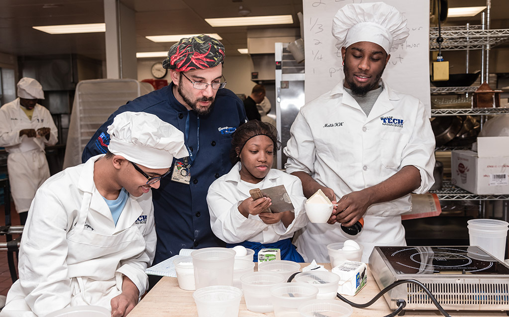 Students tag-team a recipe in the kitchens.