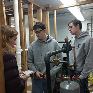 Students construct a plumbing system.