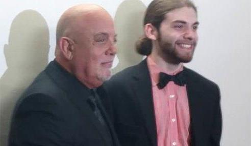 Jeremy Kaplan and Billy Joel pose for a photo