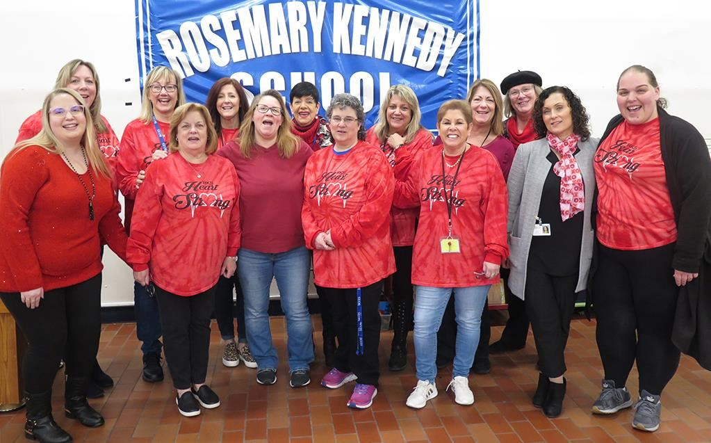 School staff members wear red