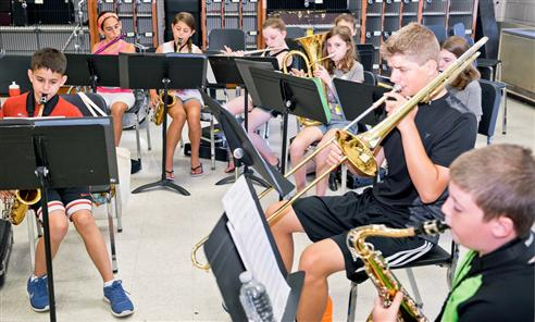 Middle schoolers play in brass band