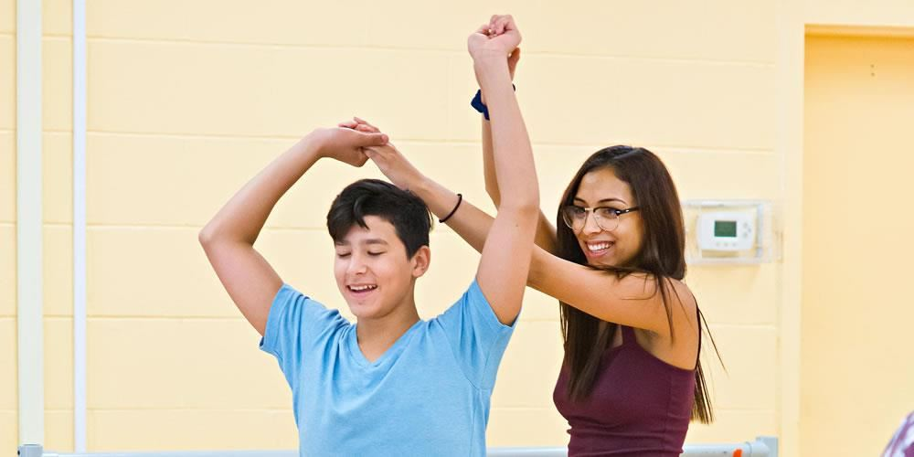 Long Island High School for the Arts students learn Latin dance techniques during a Master Class.