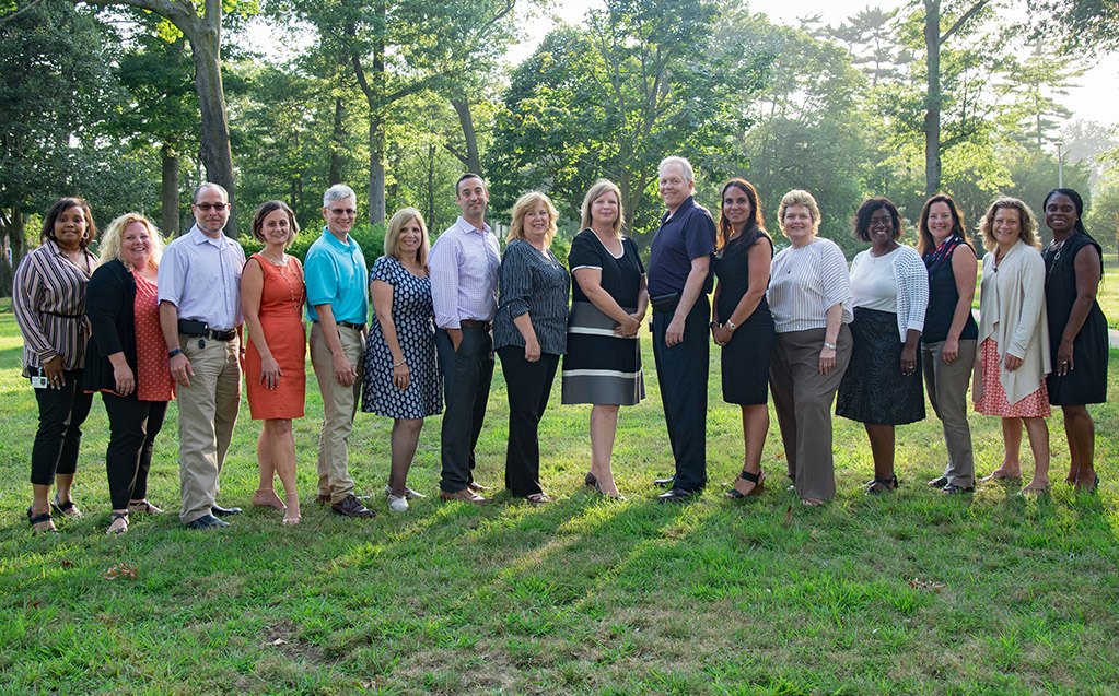A diverse group of 16 Nassau BOCES administrators poses confidently