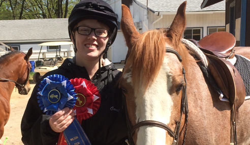 Carolyn Sill displays her horse show award ribbons