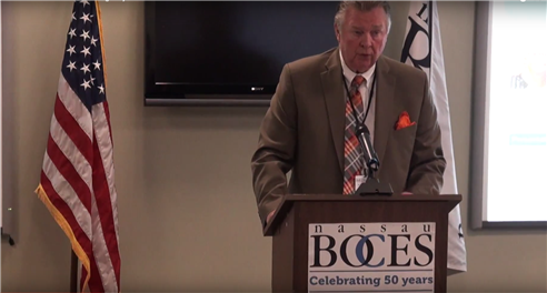 Dr. Robert R. Dillon speaks at the Nassau BOCES podium