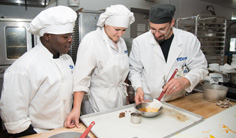 culinary students working with chef