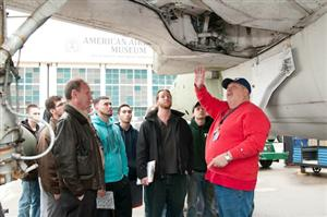 Barry Tech students look at a plane's underbelly