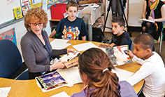 teacher with students at her desk