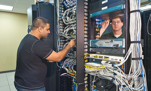 students working on a computer mainframe